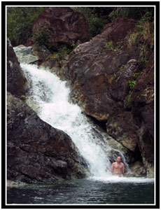 Arlo at the base of a waterfall, Photo by Emily Barrick (25k image)
