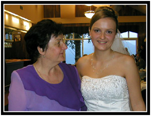 Oksana and her mother at the wedding, 08-17-02