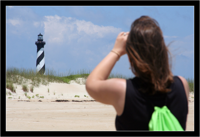 Oksana taking a picture of the Hatteras Lighthouse